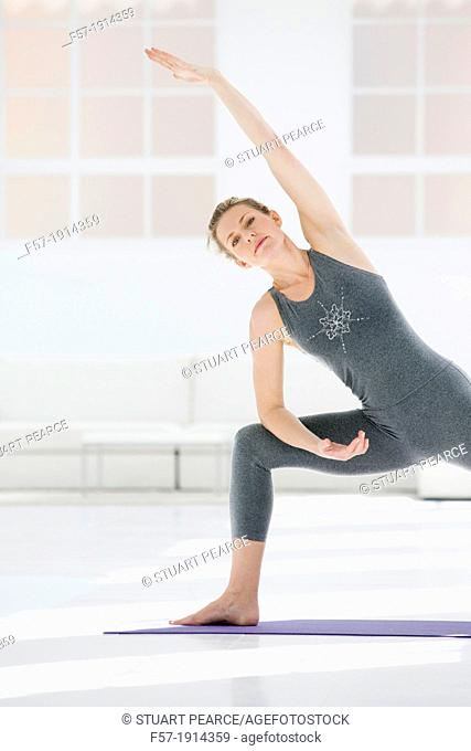 Healthy young woman doing the extended pose yoga position