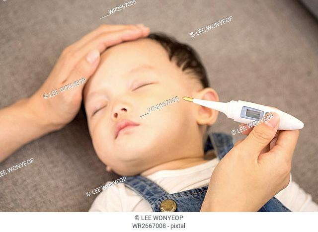 Parent taking care of sick baby