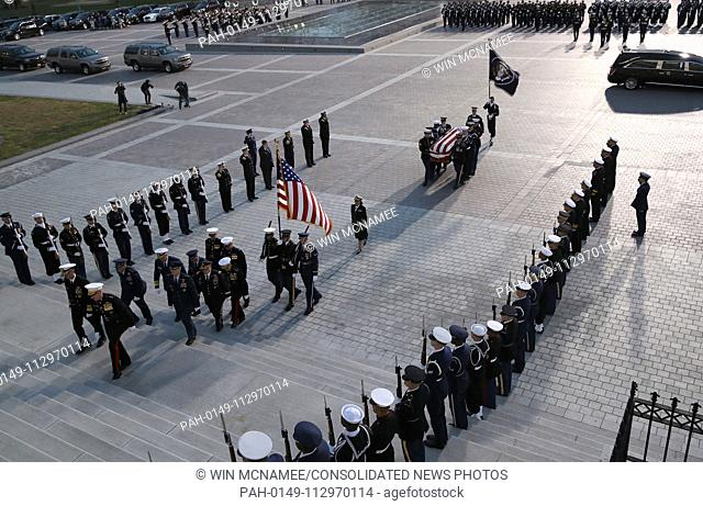 WASHINGTON, DC - DECEMBER 03: A military honor guard team carries the casket of former U.S. President George H. W. Bush into the U.S