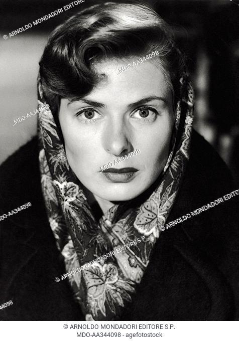 Ingrid Bergman acting. The Swedish actress Ingrid Bergman wearing a headscarf in a scene of 'No Geater Love'. 1951