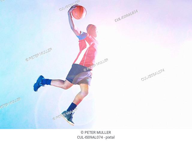 Male basketball player throwing ball