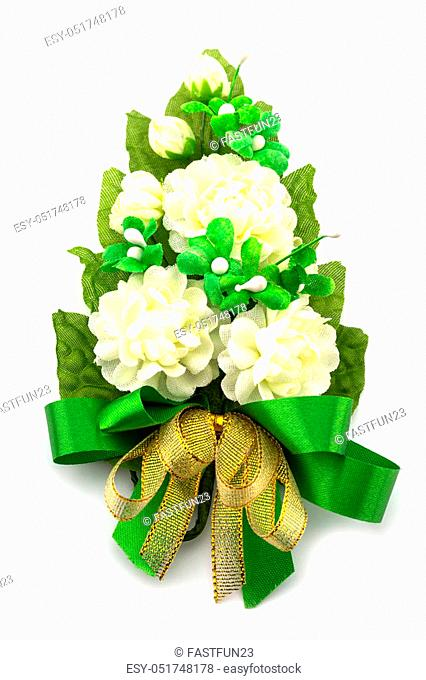 White Jasmine fabric flower with golden bow isolated on a white background