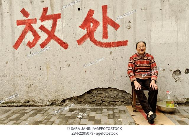A local woman in an old district, Shanghai, China, Asia
