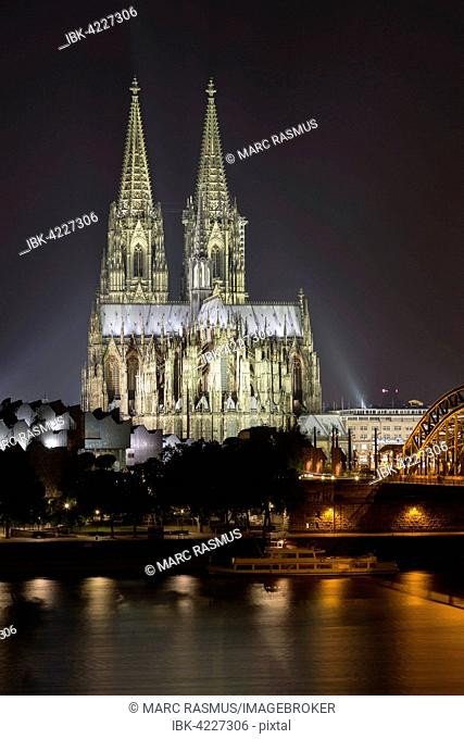 Cologne cathedral at night, Philharmonie and Hohenzollern Bridge, Rhine, Cologne, North Rhine-Westphalia, Germany