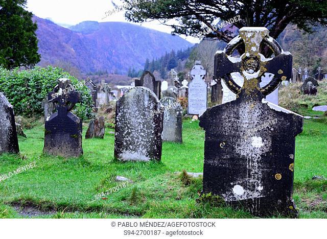 Tombstones in the cemetery of Glendalough, Wicklow county, Ireland