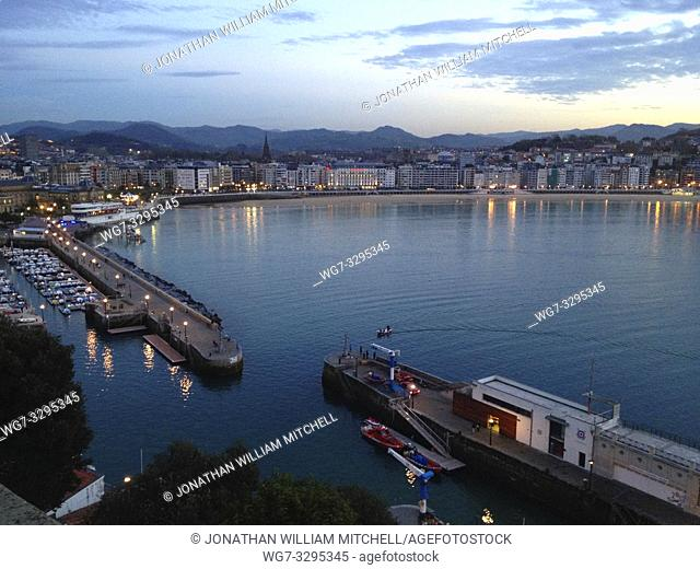 SPAIN San Sebastian / Donostia -- 19 Nov 2014 -- A small inshore fishing boat returns to port in the early evening at San Sebastian (or Donostia as the Basques...