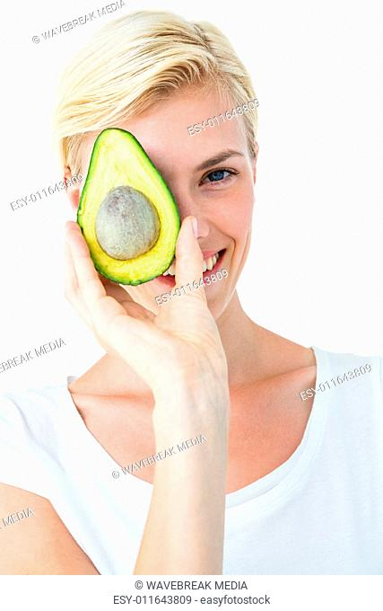 Attractive woman holding fresh avocado