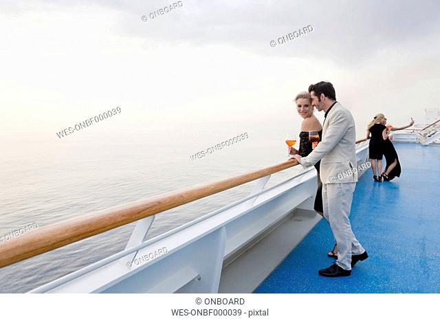 Four people with aperitive on deck of a cruise liner
