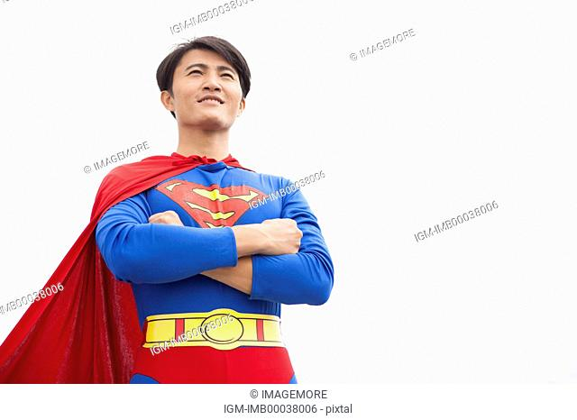 Superhero looking away with hands on chest