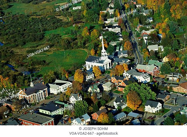 This is an aerial view of the New England village of Stowe. It is along scenic Route 100. There is autumn foliage in the trees