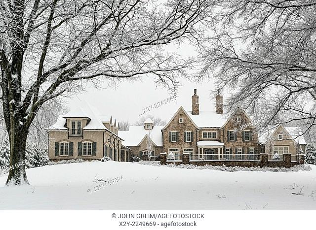 Grand country estate shrouded in winter snow