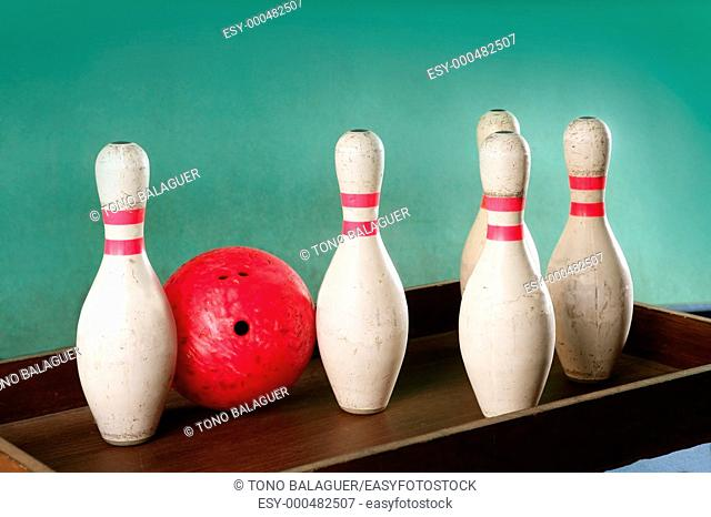 Bowling still life red ball games over green background
