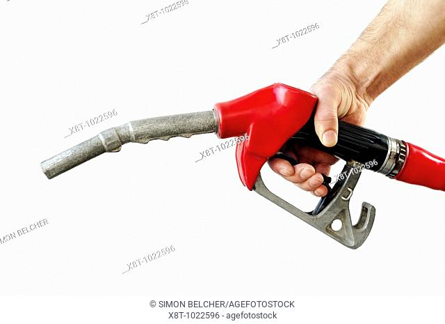 Hand Holding a Petrol Pump Nozzle Against a White Background