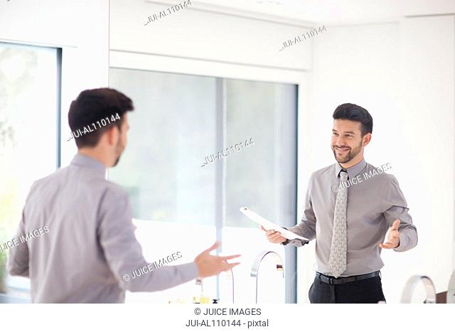 Mid adult businessman practicing presentation in mirror