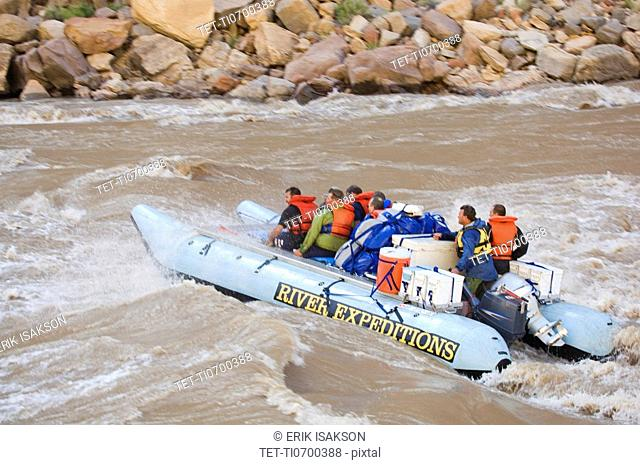 People on white water rafting tour, Colorado River, Moab, Utah, United States