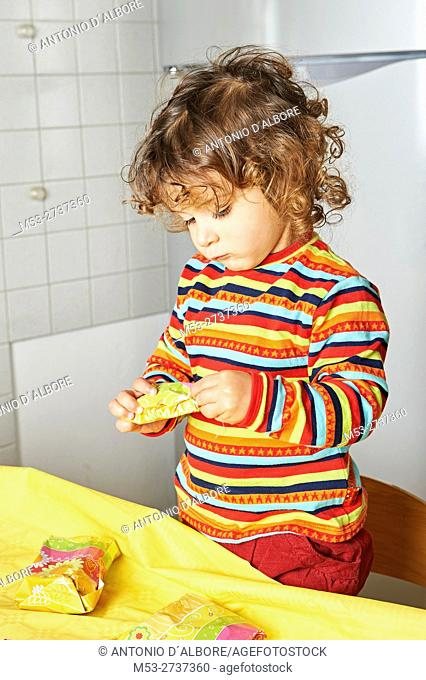 A two years old girl unwrap her birthday present