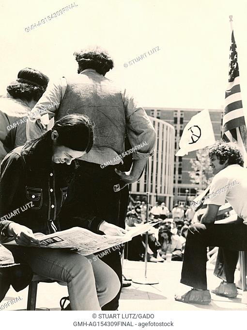 Students sit on stage and read a newspaper during an anti Vietnam War student sit-in protest at North Carolina State University, Raleigh, North Carolina