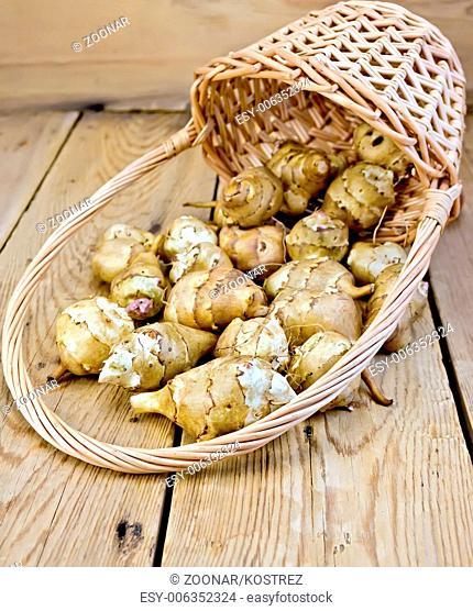 Jerusalem artichokes with basket on board