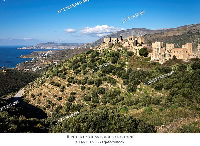 The stone tower houses of the village of Vathia and the dramatic coast of the Deep Mani in the background, Southern peloponnese, Greece
