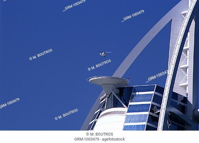 A helicopter landing on top of Burj Al Arab Hotel in Dubai, United Arab Emirates