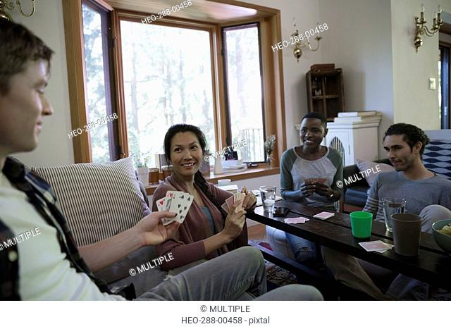 Couples playing cards in living room