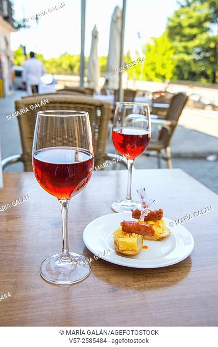 Two glasses of rose wine and tapa in a terrace. Madrid, Spain
