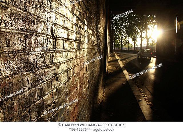 scene under dark bridge in rome italy