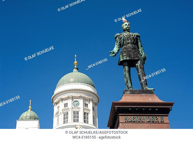 Helsinki, Finland, Europe - A statue of Alexander II is seen in front of Helsinki Cathedral at Senate Square, also known as White Cathedral or Helsingin...