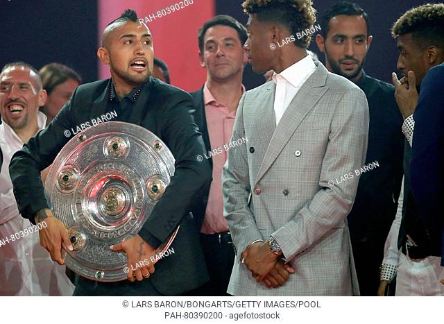 MUNICH, GERMANY - MAY 14: Arturo Vidal holds The Meisterschale, the trophy of the German football championship next too David Alaba during the FC Bayern...