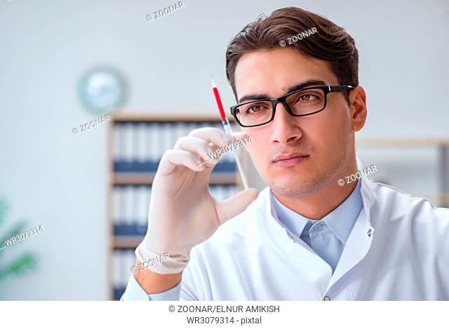 Young doctor with the syringe