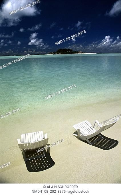 High angle view of two Adirondack chairs on the beach, Maldives