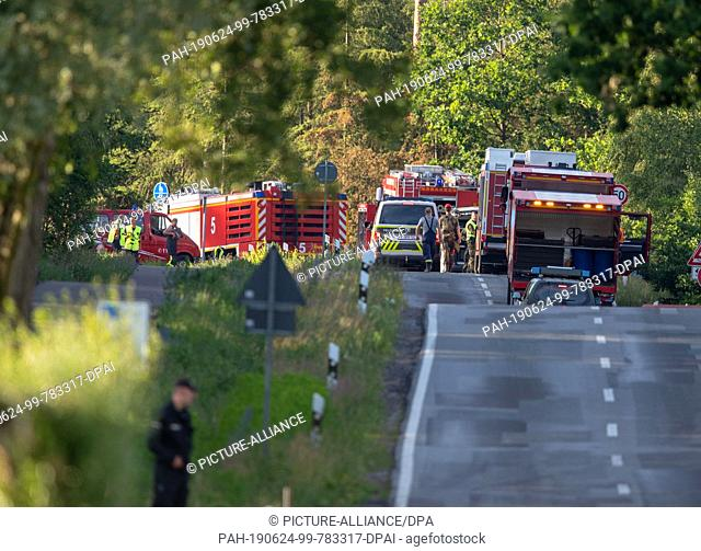 24 June 2019, Mecklenburg-Western Pomerania, Jabel: Firefighters, German armed forces and policemen work near the crash sites of a Eurofighter near Jabel