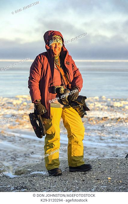 Photographer Lynn Hackett along the Hudson Bay coast, Churchill, Manitoba, Canada