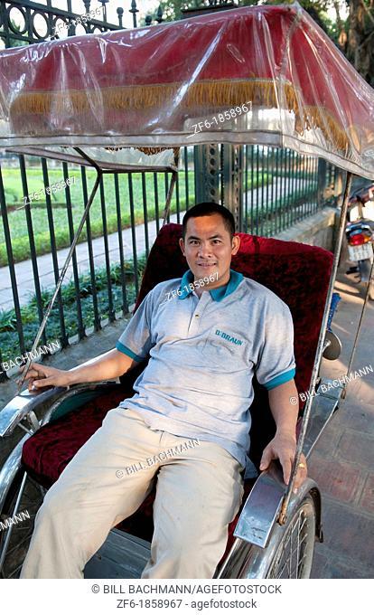 Portrait of rickshaw driver in Hanoi Vietnam on streets