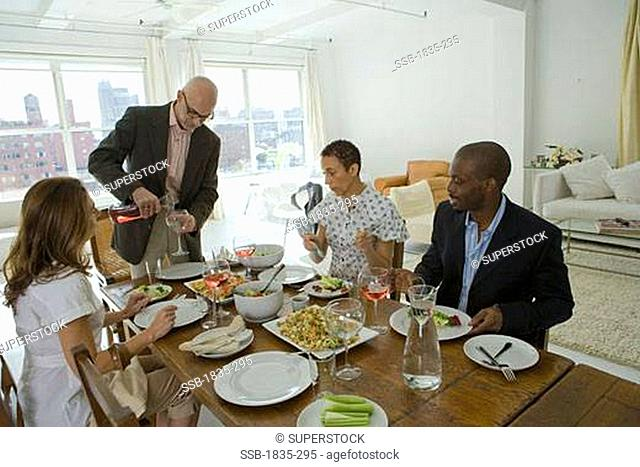 Two men and two women at a dining table