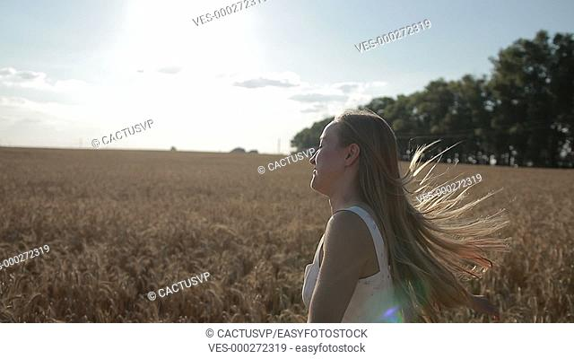 Charming woman enjoying nature in summertime