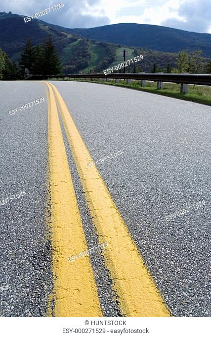 Close up of yellow divider lines on a highway