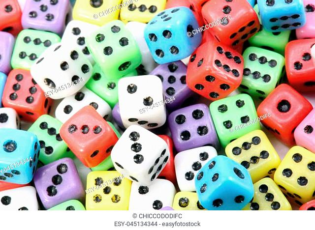 background of gaming dice with black dots