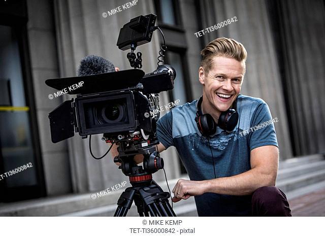 Portrait of smiling camera operator
