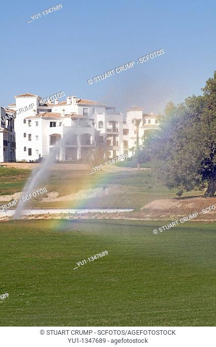 Rainbow colours in the water from the sprinklers on the golf course at the Polaris World Hacienda Riquelme development, Murcia, Spain, Europe