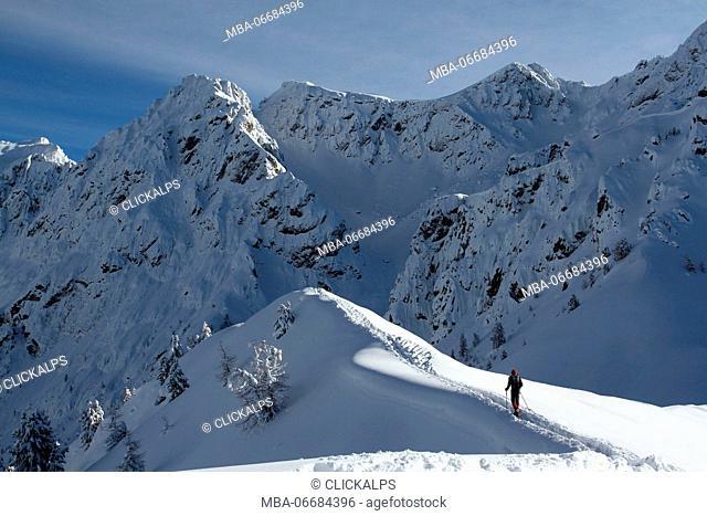 Snowshoes on Sass da Pecol ridge, Val di Fassa, Province of Trento, Trentino Alto-Adige, Italy