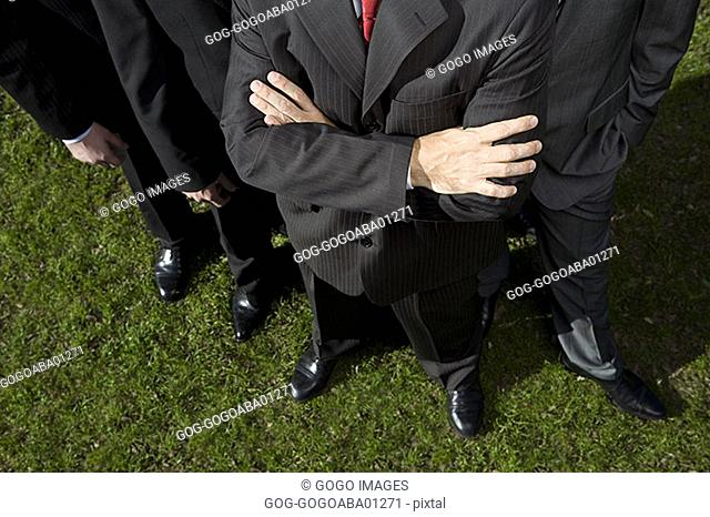 Businessman standing with crossed arms
