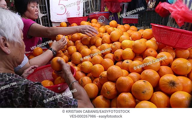 People grapping oranges, market, Hong Kong, China, Asia
