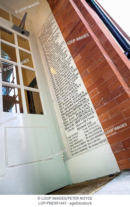 List of barristers and judges names at entrance to Hare Court Inner Temple in London