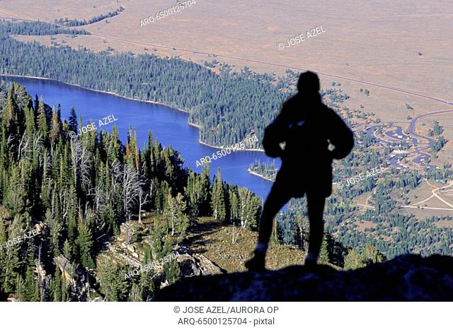 Hiker looks over the Jackson Hole valley, Wyoming, USA