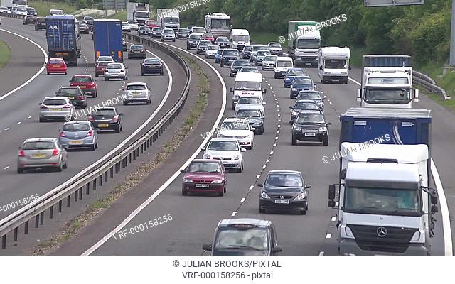 busy motorway time lapse traffic driving round a curve