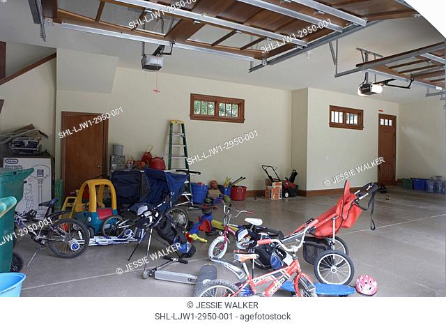 GARAGE: Messy garage filled with toys and sporting equipment, before new storage is placed