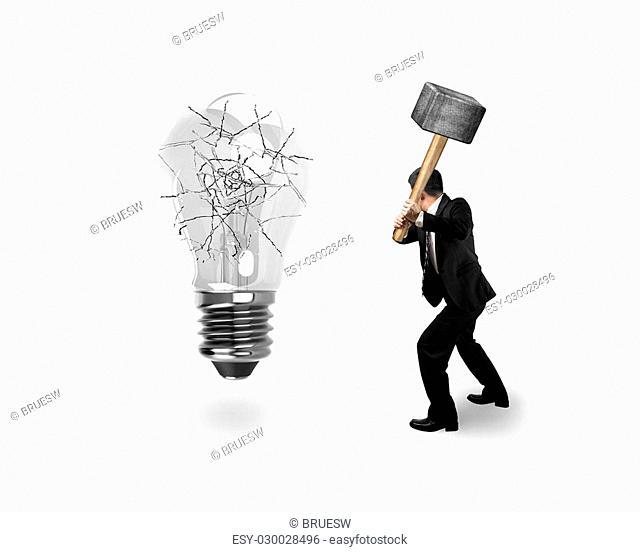 Man using hammer hitting light bulb with cracks, isolated on white background