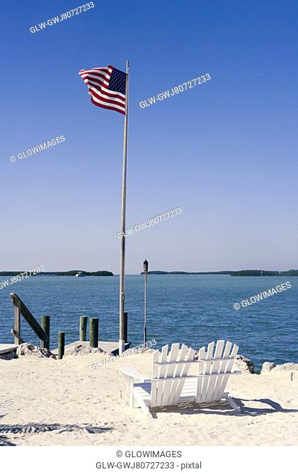 American flag fluttering on the beach
