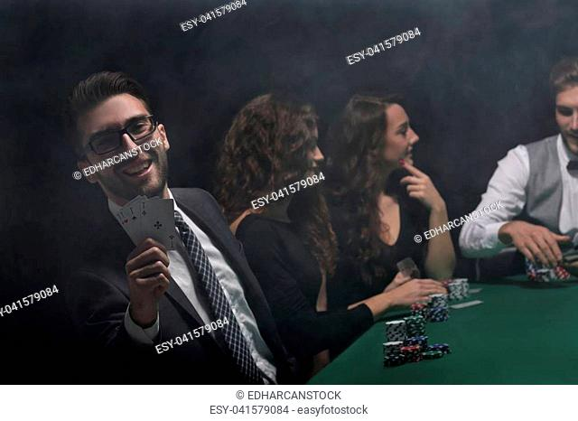 background image. game of poker. players sitting at a green gaming table